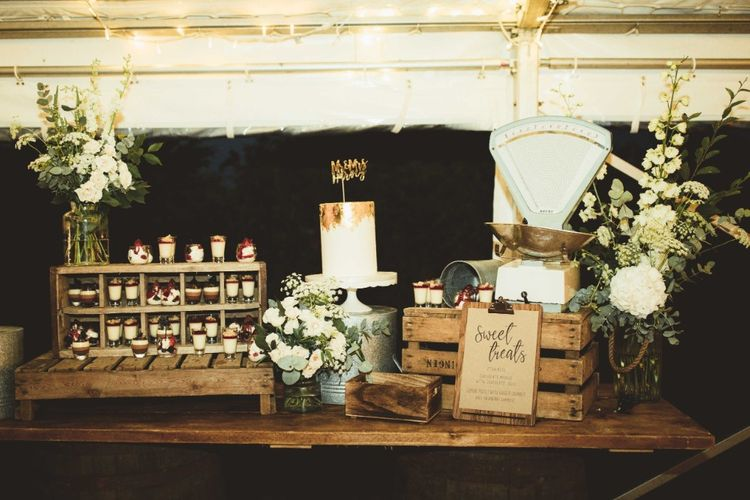 Dessert Table   Rustic Wooden Table with Crates   White Flowers and Eucalyptus   Quintessential English Country Wedding in Glass Marquee at Family Home   Maryanne Weddings Photography