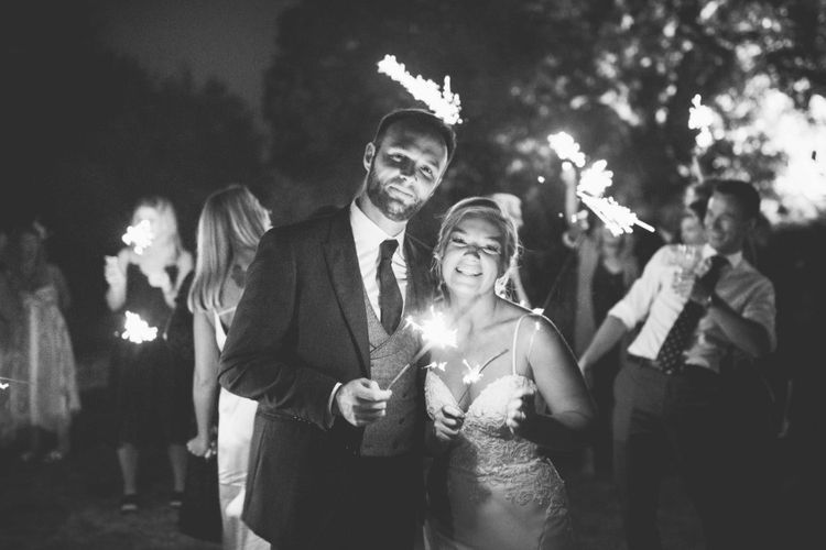 Sparklers   Bride in Essense of Australia Dress with Spaghetti Straps and Fishtail   Groom in Blue Suit with Grey Waistcoat   Quintessential English Country Wedding in Glass Marquee at Family Home   Maryanne Weddings Photography