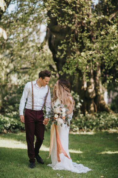 Boho Bride and Groom Holding Hands