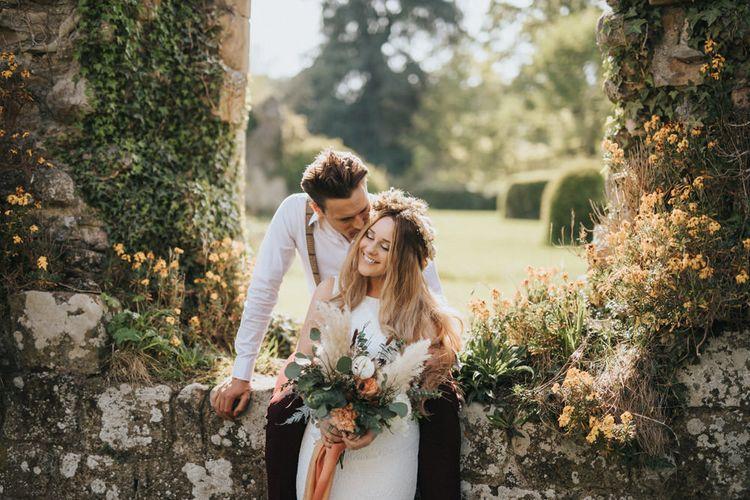 Boho Bride and Groom Kissing at Jervaulx Abbey