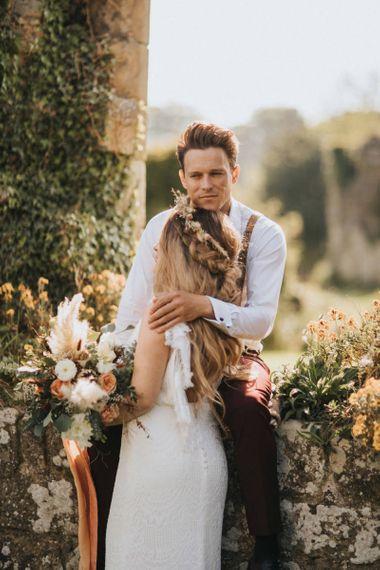 Boho Bride and Groom Embracing at Jervaulx Abbey