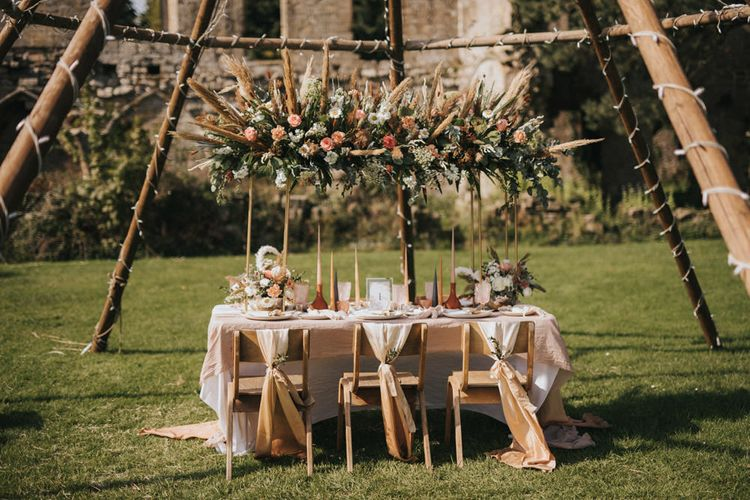 Outdoor Tablescape with Floral Installation, Linens, and Taper Candles