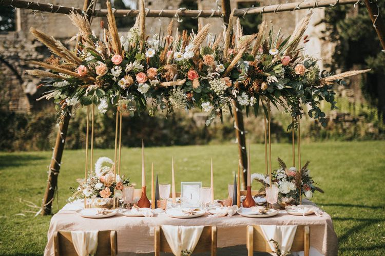 Tablescape with Linen Tablecloth, Taper Candles and Floral Installation