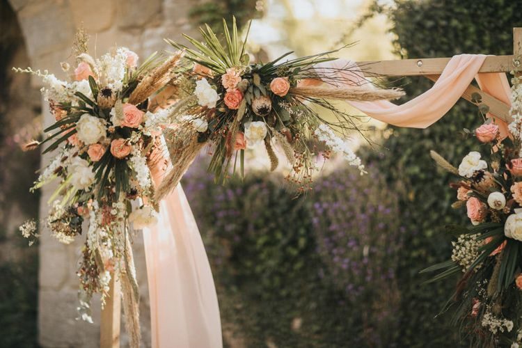 Floral Arch with Dried Grasses, Foliage, Coral Roses and Proteas