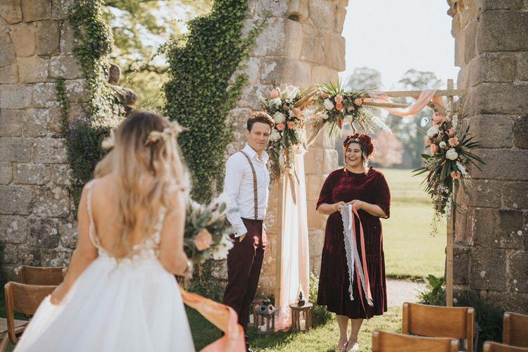 Outdoor Wedding Ceremony with Wooden Fram Altar
