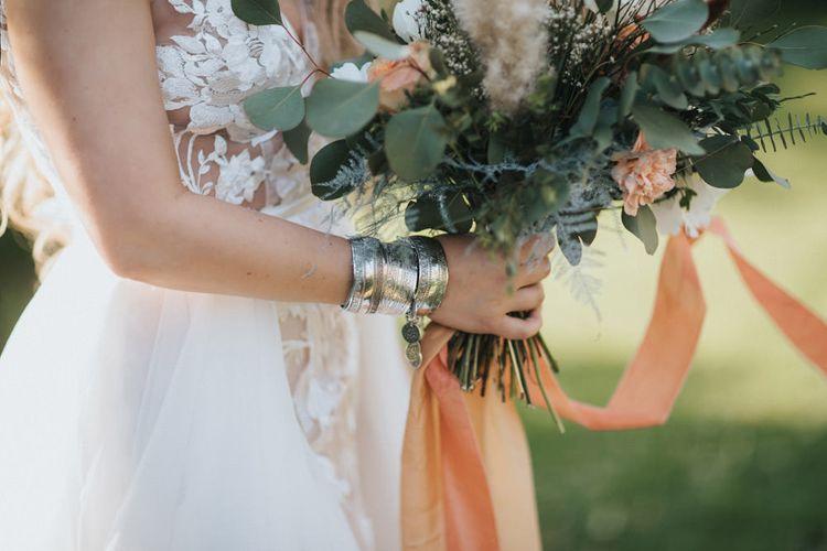Boho Bride Wearing Silver Bangles