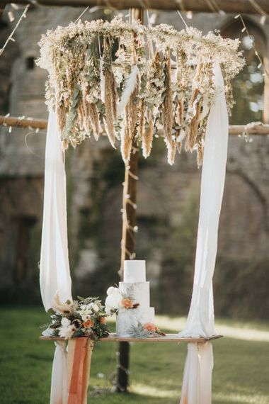 Swing Cake Table with Foliage and Dried Flower Hanging Chandelier Decor