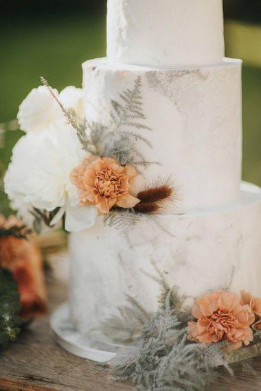Three Tier Marble Wedding Cake with Flower Decor