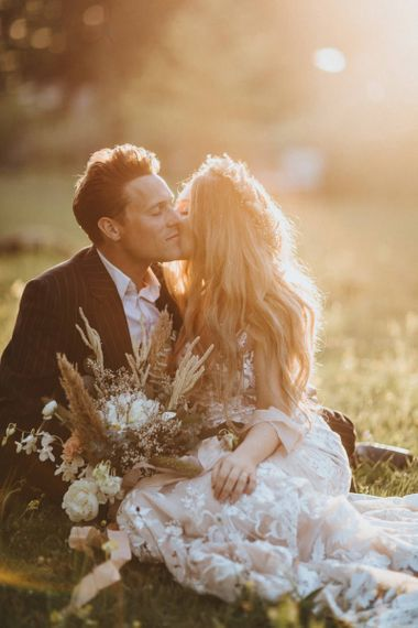 Golden Hour Portrait with Bride in Lace Wedding Dress and Dried Flower Bouquet