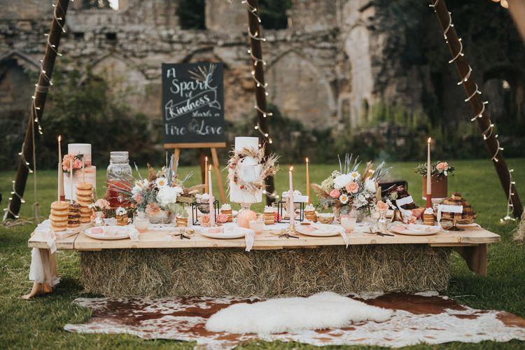 Dessert Table with Wedding Cake, Stacking Doughnuts,  Taper Candles and Wedding Flowers