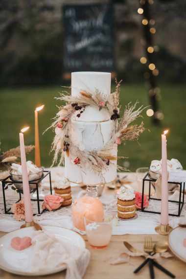 Three Tier Wedding Cake with Dried Grass Hoop Wedding Decor