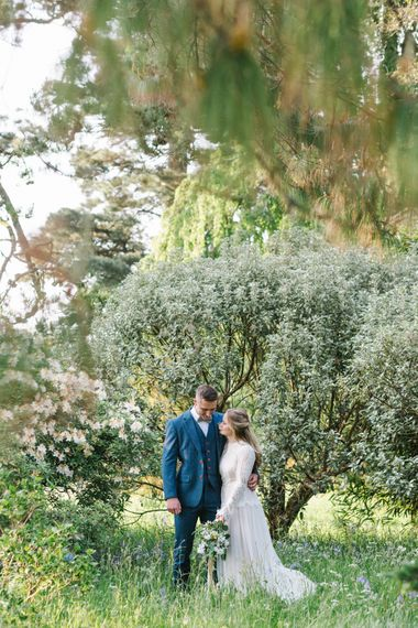 Bride in Rock The Frock Bridal Gown via The Wedding Hub | Groom in Navy Blue Wool Three Piece Suit The Vintage Suit Hire Company | Timeless English Country Garden Inspiration at Boconnoc House and Estate in Cornwall, Styled by On Serpentine Shores | Debs Alexander Photography