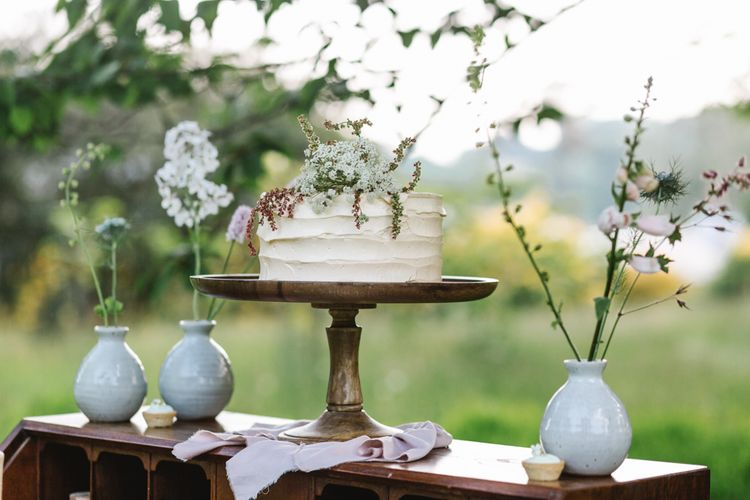 Elegant Single Tier Peboryon Wedding Cake on a Vintage Dresser | Timeless English Country Garden Inspiration at Boconnoc House and Estate in Cornwall, Styled by On Serpentine Shores | Debs Alexander Photography