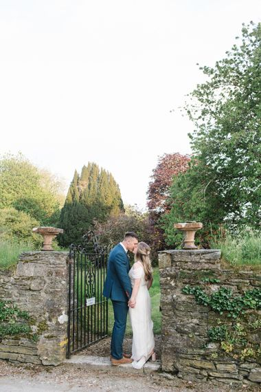 Bride in Bardot Shoulder Rock The Frock Bridal Gown via The Wedding Hub | Groom in Navy Blue Wool Three Piece Suit The Vintage Suit Hire Company | Timeless English Country Garden Inspiration at Boconnoc House and Estate in Cornwall, Styled by On Serpentine Shores | Debs Alexander Photography