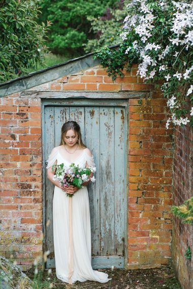 Bride in Bardot Shoulder Rock The Frock Bridal Gown via The Wedding Hub | The Garden Gate Flower Company Wedding Bouquet | Timeless English Country Garden Inspiration at Boconnoc House and Estate in Cornwall, Styled by On Serpentine Shores | Debs Alexander Photography