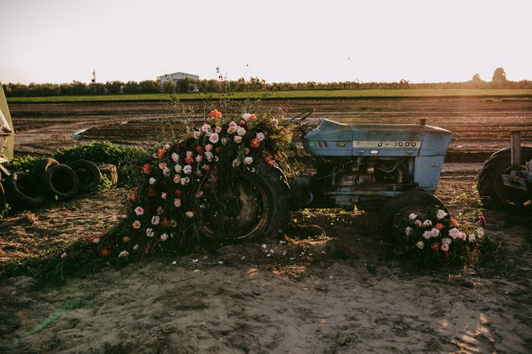 Flower covered tractor at golden wedding anniversary