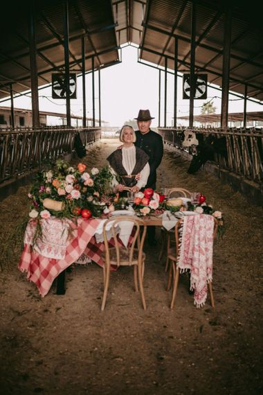 Couple celebrating their golden wedding anniversary with feast