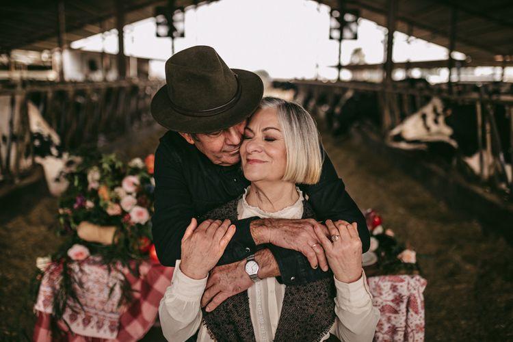 Couple embracing at golden wedding anniversary celebration