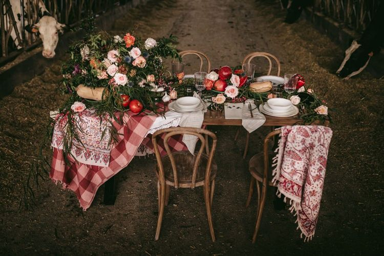 Intimate tablescape with gingham cloth, bread and apples