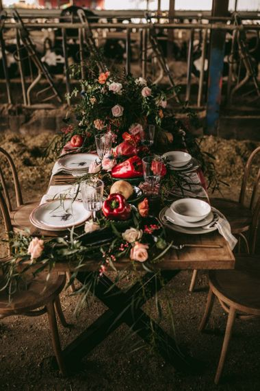 Intimate tablescape with flowers, fruits and vegetables