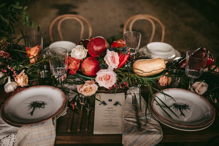 Place settings with patterned tableware and fruit centrepieces
