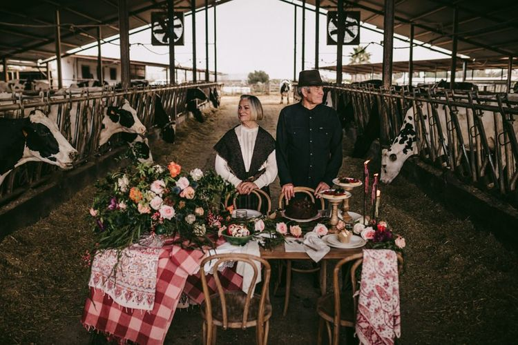 Couple portrait in front of the dessert table