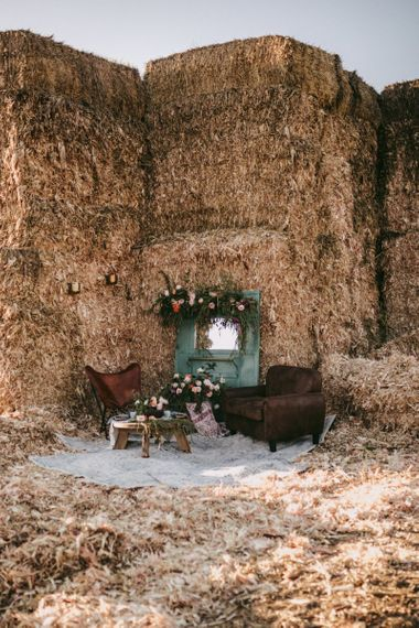 Chill out area with chairs and barn door decorated in flowers