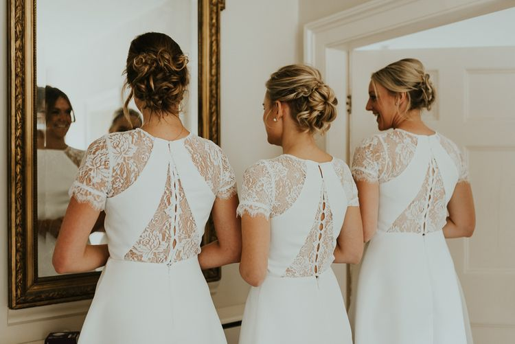 Family Home Wedding In The Cotswolds With Vintage Porsche Tractor Bride In Grace Loves Lace Bridesmaids In White Dresses Images Virginia Photography