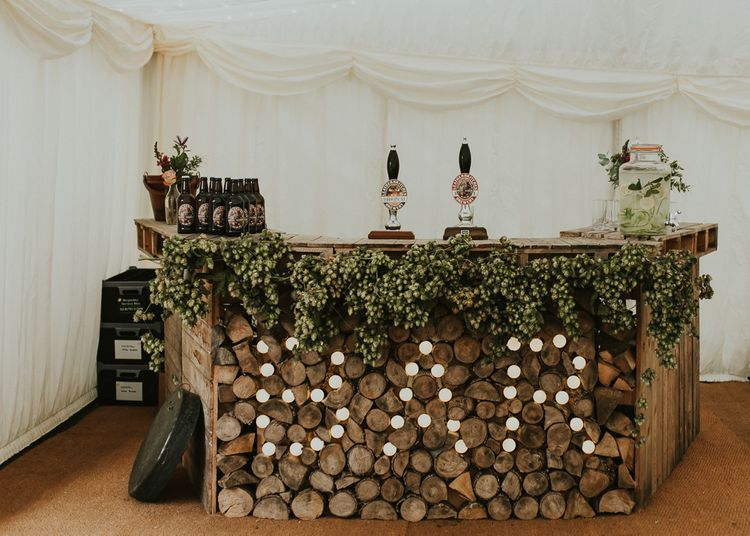 Wedding Bar For Marquee // Family Home Wedding In The Cotswolds With Vintage Porsche Tractor Bride In Grace Loves Lace Bridesmaids In White Dresses Images Virginia Photography
