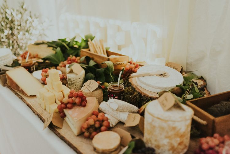 Cheese And Crackers Wedding Food // Family Home Wedding In The Cotswolds With Vintage Porsche Tractor Bride In Grace Loves Lace Bridesmaids In White Dresses Images Virginia Photography