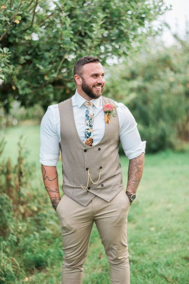 Groom in Chinos With double breasted waistcoat and floral tie // Macrame Ceremony Backdrop Rustic Hippie Wedding The Great Barn Dream Catchers And Oversized Florals Bride In Essence Of Australia Images Kathryn Hopkins
