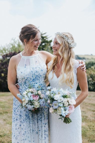 Bride in Sophia Tolli Galene Wedding Dress and Bridesmaid in Blue & White Floral Dress