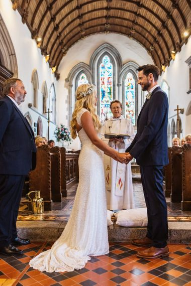 Church Wedding Ceremony with Bride in Sophia Tolli Galene Wedding Dress and Groom in Navy Blue Ted Baker Suit