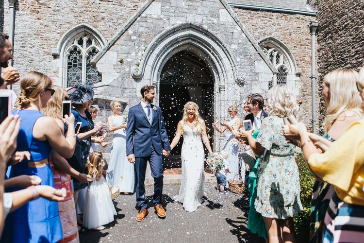 Confetti Exit with Bride in Sophia Tolli Galene Wedding Dress and Groom in Navy Blue Ted Baker Suit