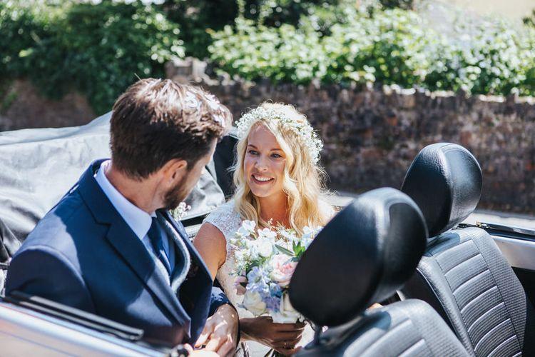 Bride in Sophia Tolli Galene Wedding Dress and Groom in Navy Blue Ted Baker Suit Sitting in Convertible VW Beetle Wedding Car