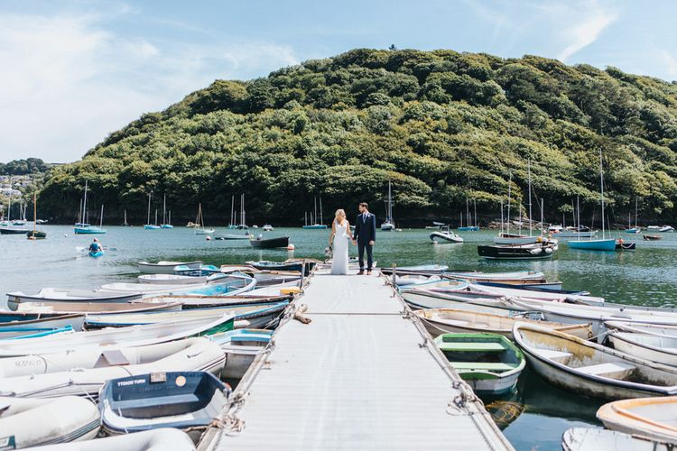 Bride in Sophia Tolli Galene Wedding Dress and Groom in Navy Blue Ted Baker Suit Portrait on the Dock