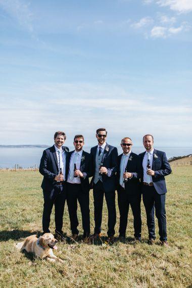 Groomsmen in Navy Blue Suits