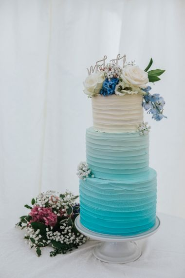 Blue and White Ombre Wedding Cake with Floral Cake Topper