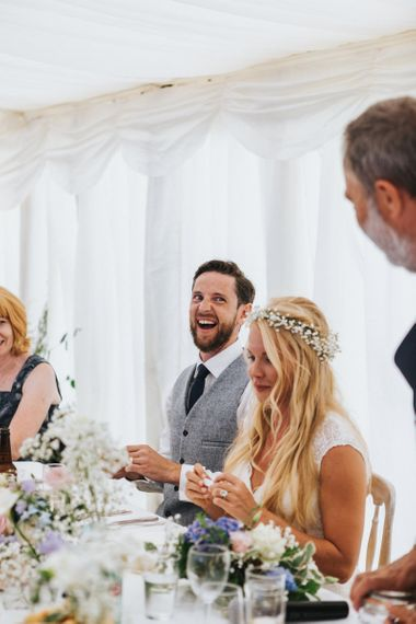 Bride and Groom Laughing at Marquee Wedding Reception