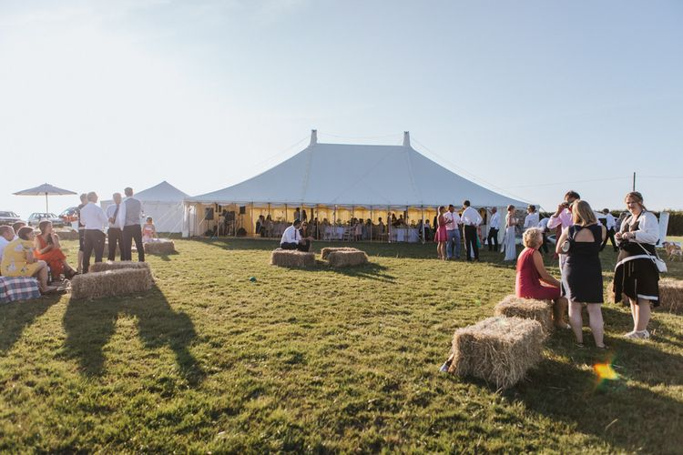 Stretch Tent Wedding Reception at Carswell Weddings in Devon with Outdoor Hay Bale Seating Area
