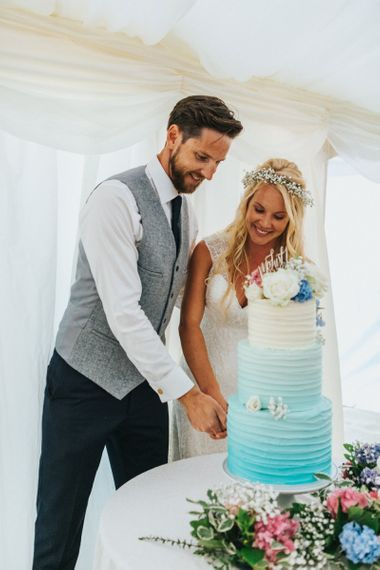 Bride and Groom Cutting tHe Blue Ombre Wedding Cake