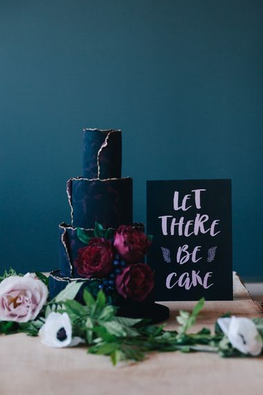 Wedding Cake With Delicate Black Icing And Fine Gold Details //Authentic Festival Weddings At In The Wyldes Wedding Venue Site With Stage, Bar And Camping Area For Ready-to-go Festival Wedding