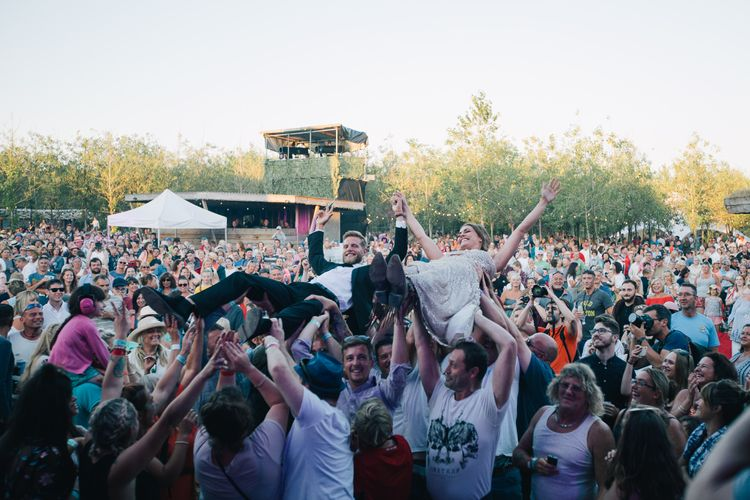 Crowd Surfing Bride & Groom // Authentic Festival Weddings At In The Wyldes Wedding Venue Site With Stage, Bar And Camping Area For Ready-to-go Festival Wedding