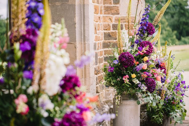 Brightly Coloured Floral Arrangements In Urns // Image By Studio TM