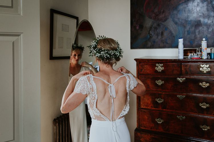 Bride in Handmade by Laura M Davey Wedding Dress with Low Back and Ribbon Detail Getting Ready