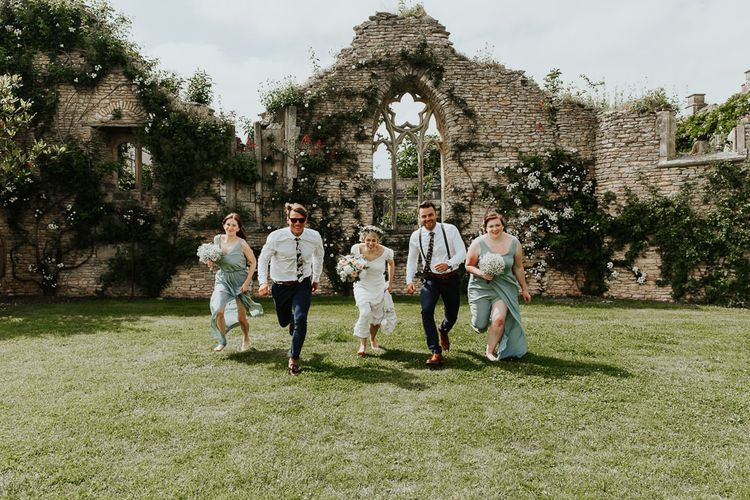 Wedding Party Running Through the Beautiful Gardens of Euridge Manor (The Lost Orangery)