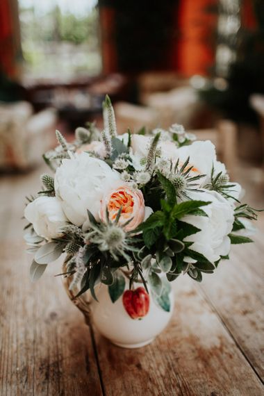 White Peonies, Peach David Austin Roses, Thistles and Foliage Floral Arrangement in Ceramic Pot