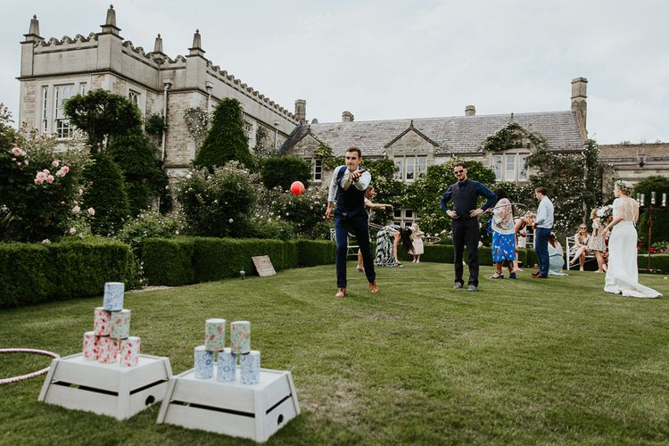 Wedding Guests Playing Tan Can Alley Garden Games at Euridge Manor