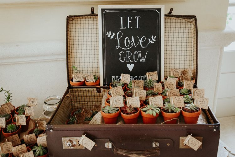 Vintage Suitcase Filled with Individual Pots of Succulents as Wedding Favours