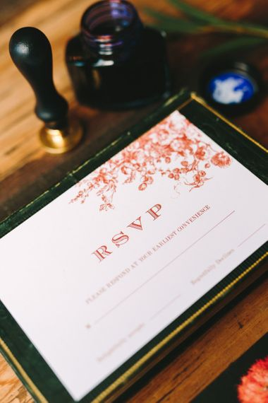RSVP Card with Red Font and Floral Motif
